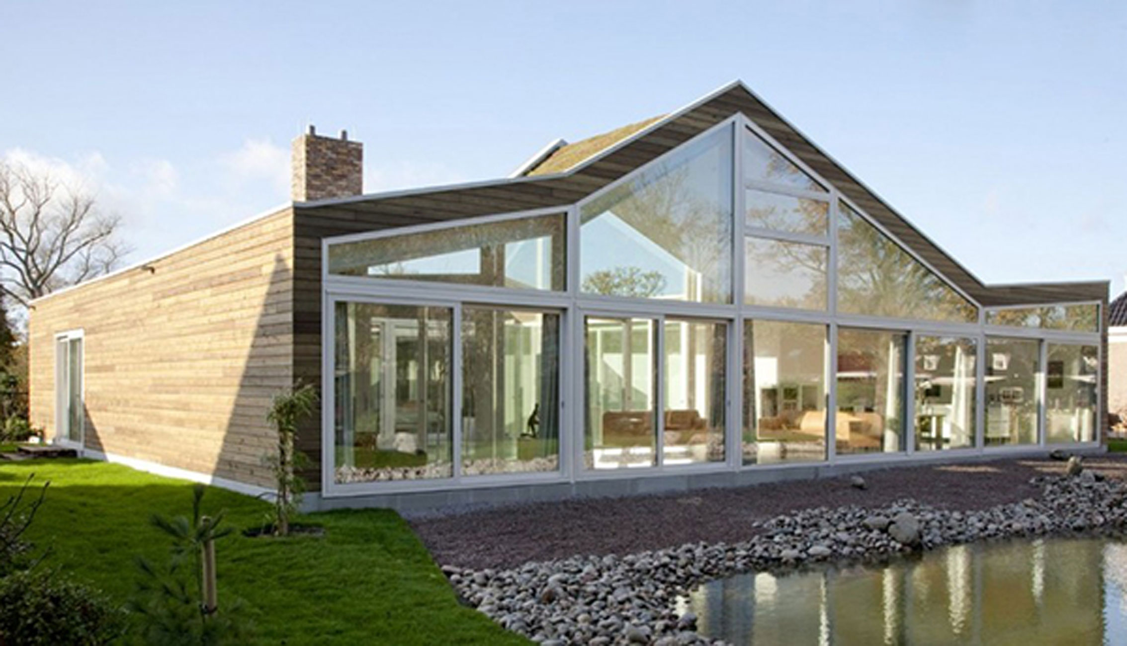 Ranch House with Glass Faade and Contemporary Design Terrace