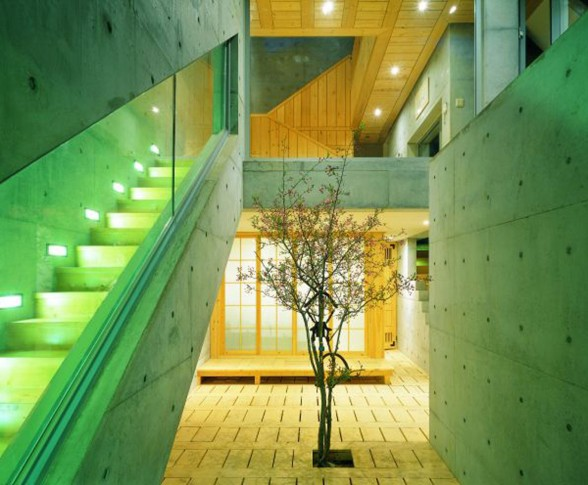 Great Combination of Wood and Concrete in a Courtyard House Design - Staircase with Lamp Decoration
