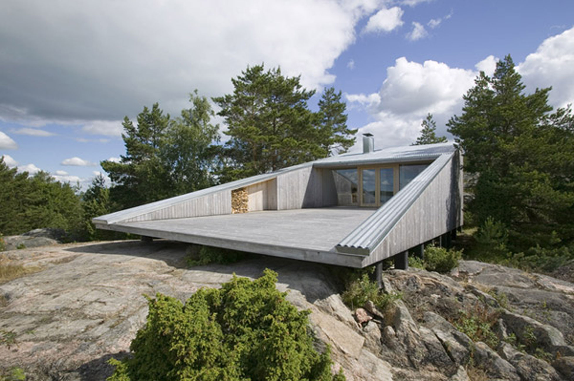 Lake house design with unusual architecture in finland for Lake home landscape design