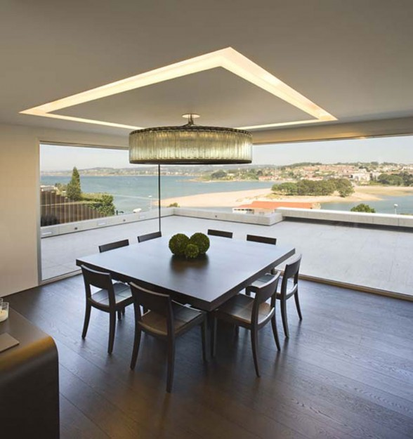 Modern Glass House Design in Cliff Side of Galicia Spain - Wooden Dining Table