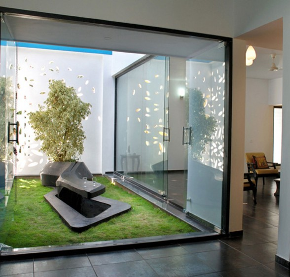 Modern House Design with Beautiful Wall Details in India - Indoor Garden