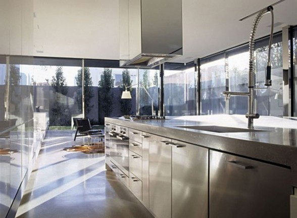 Modern Interior Design for a Contemporary Concrete House in Australia - Stainless Steel Kitchen