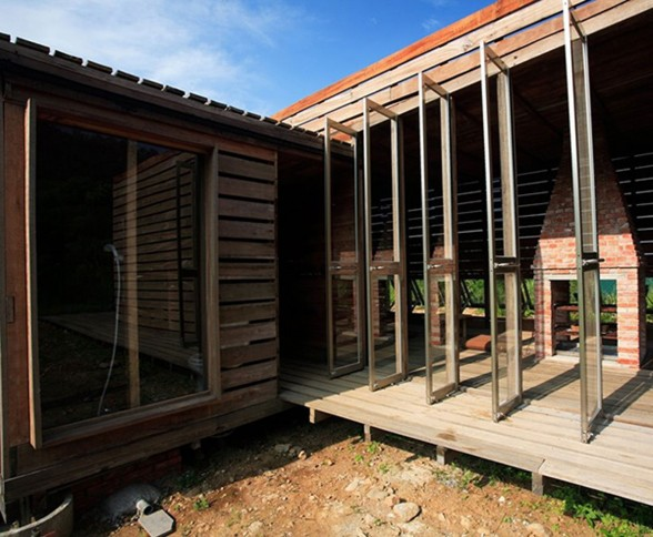 Timber House with Mahogany Materials from Marco Casagrande - Doors