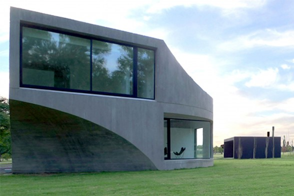 Unique Shape of a Concrete House with Modern Interior Design in Argentina - Entrance