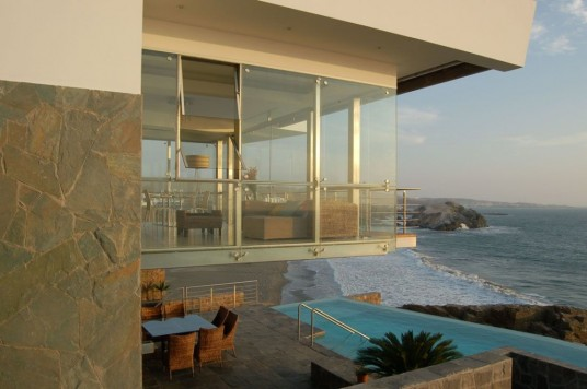 Modern Beach House Architecture with Pool and Exterior Dining Area