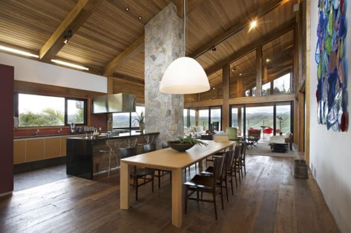 Rock and wood combination mountain house from david guerra architecture kitchen