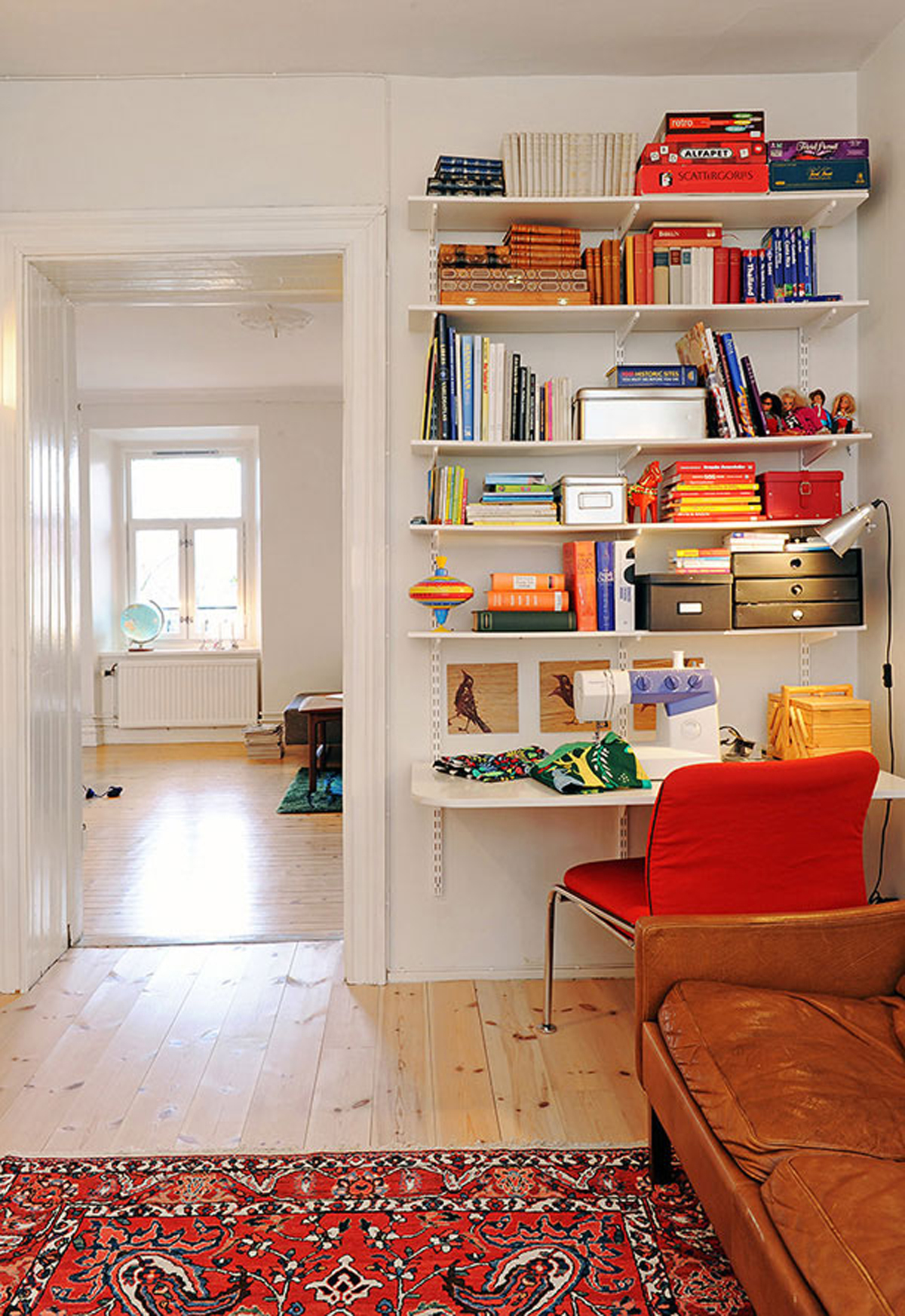 Three rooms apartment diverse with homey interior reading desk