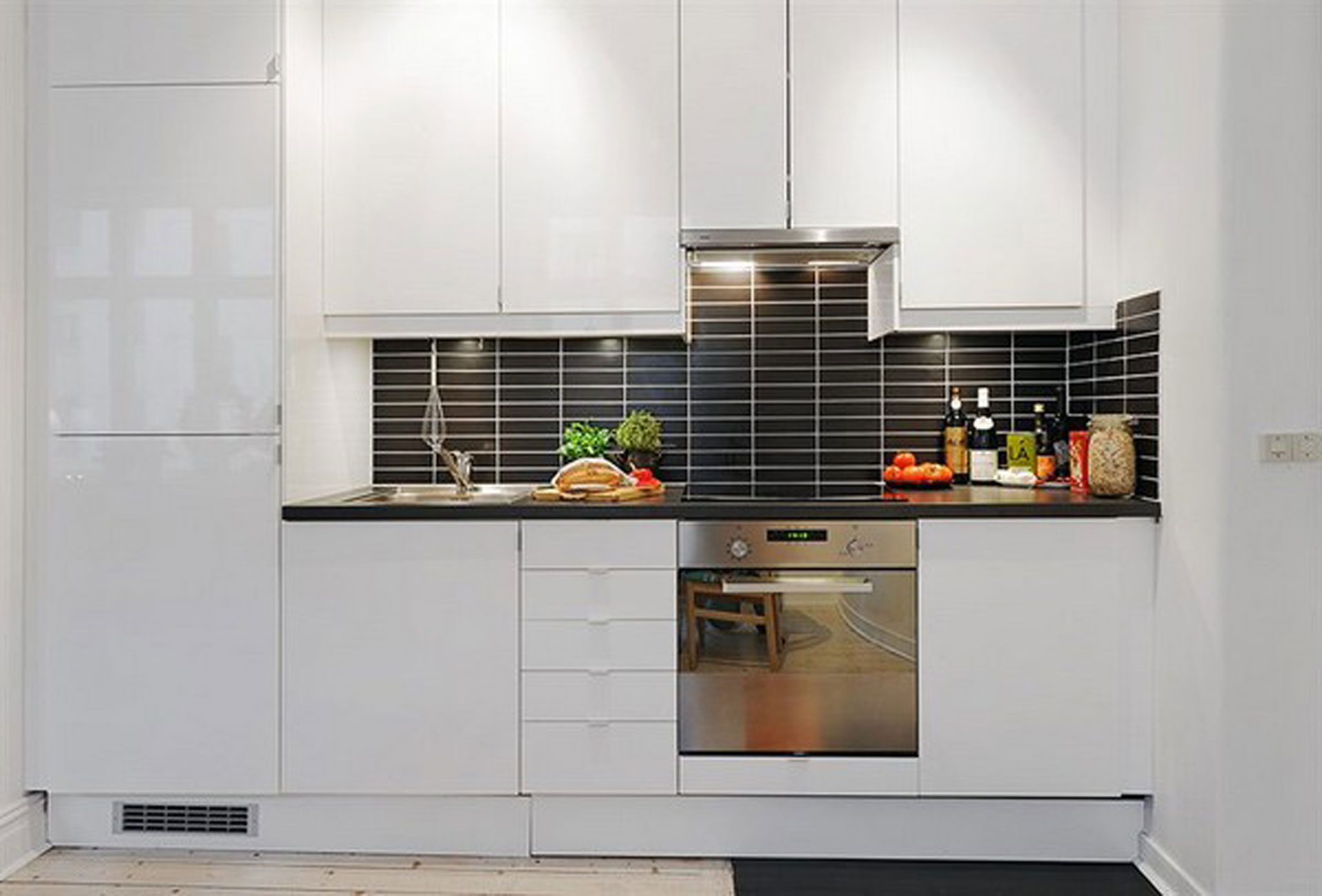 Contemporary apartment design in small loft area and bright interior kitchen