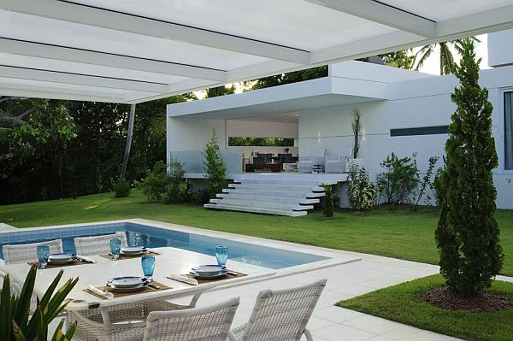 White Contemporary House in Brazil with Swimming Pool - Dining Table ...