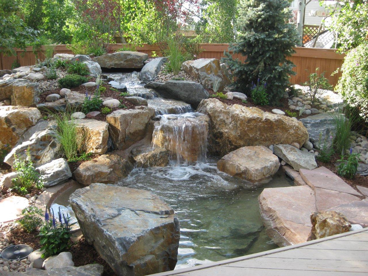 Beautiful Landscape Stone Garden Backyard Water Features With Wooden Fence